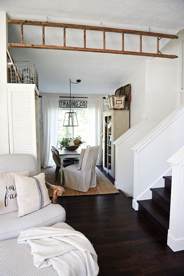 Using an antique ladder as a faux wooden beam - It adds a visual separation of two rooms & adds a lot of character as well!