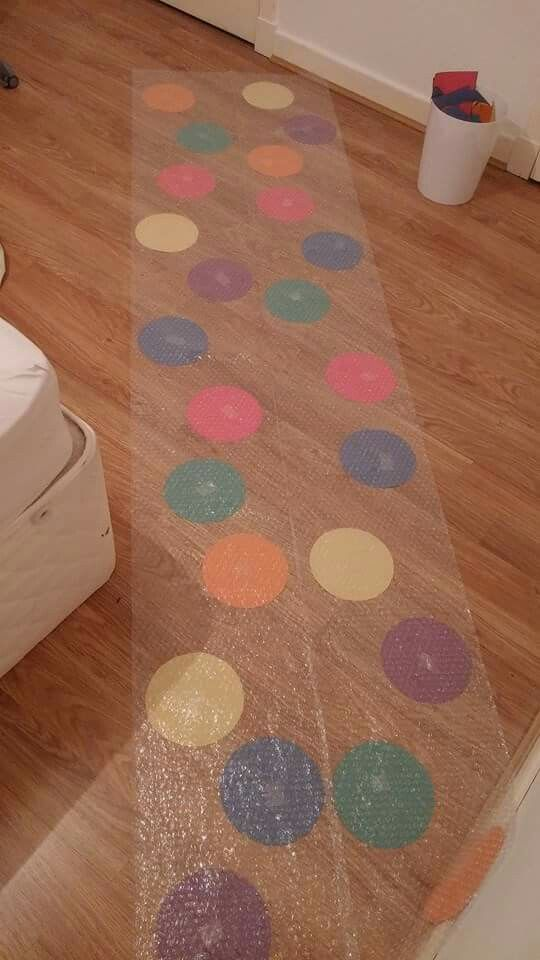 Bubble wrap singing time... primary hop and pop.  Songs written on colored circles, spin a wheel to choose color.. or colors on dice.  Kid gets to hop and pop bubble wrap and then they all sing song.
