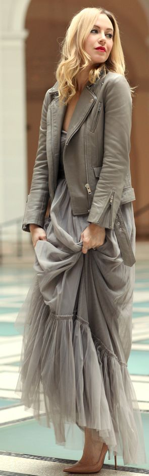 Long grey tulle dress and grey leather jacket.