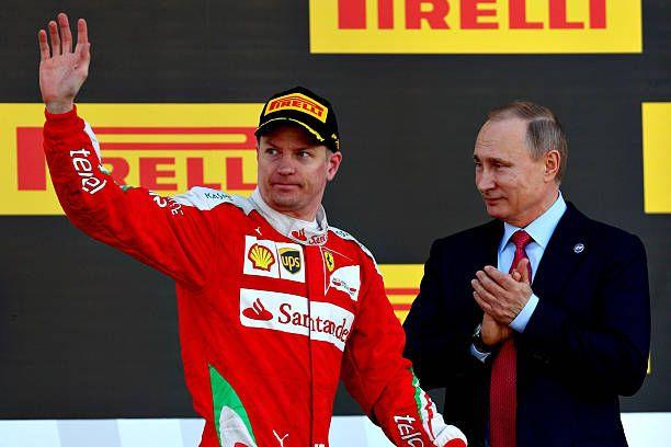 Kimi Raikkonen of Finland and Ferrari walks past Russian President Vladimir Putin on the podium during the Formula One Grand Prix of Russia at Sochi...