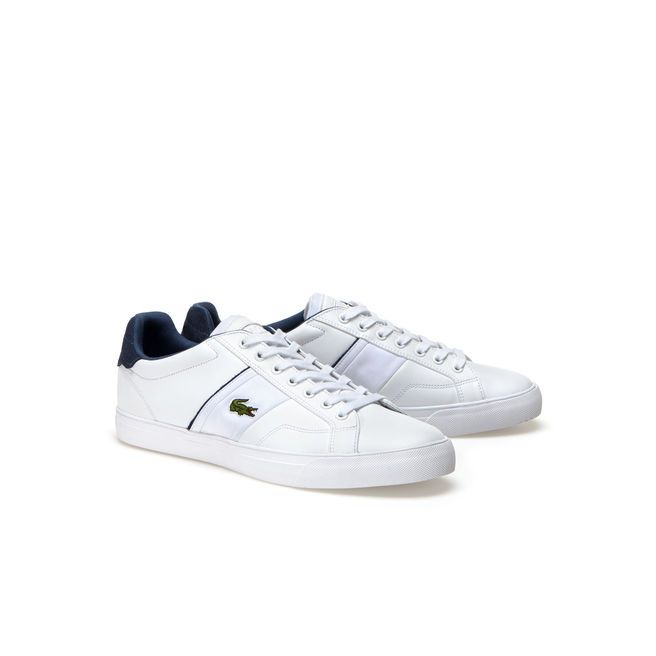 You can stroll or make a run for it in these sporty low-rise trainers in premium leather. Pair their white outsole with denims. There's no stopping you now!
