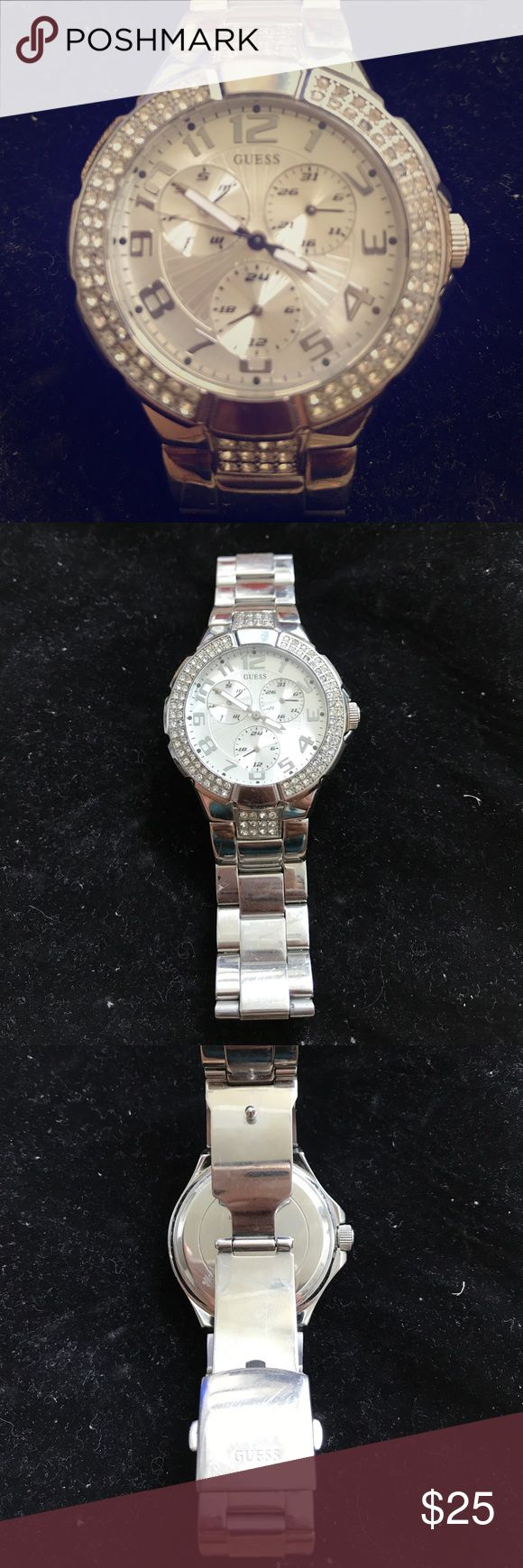 Guess Women's Watch This Watch is a statement piece for sure! Large face embellished with rhinestones. Three different faces embedded within the large face to show day of the month, military time and day of the week. Small scratches on the clasp but otherwise in great condition. Will need a Watch battery. Guess Accessories Watches