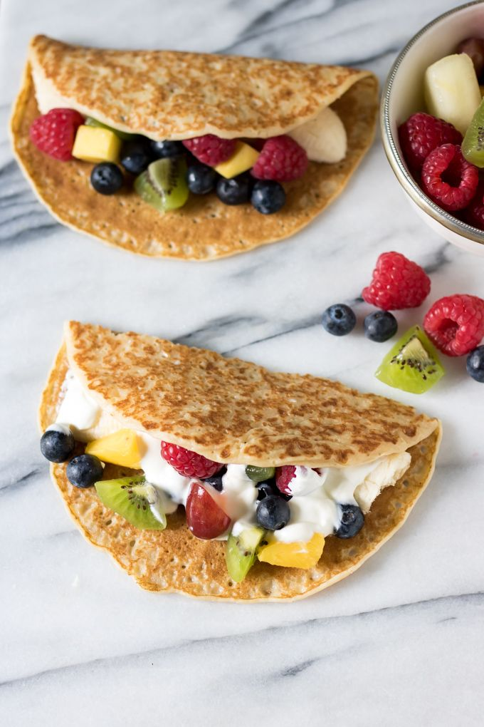 Fruit tacos are a fun, but healthy, dessert for kids and grown ups. The fruit filled crepes are quick, easy and endlessly customisable.