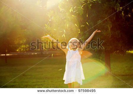 girl playing in the sun - stock photo