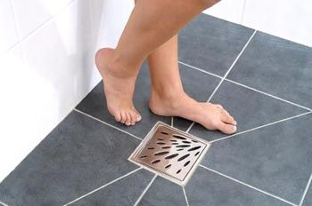 wet room example of cutting large tiles to angle to drain