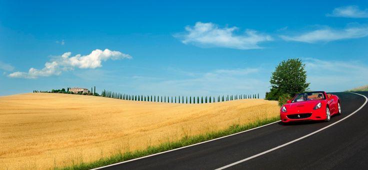the iconic Tuscan landscape.  #ferrari #Italy #luxury