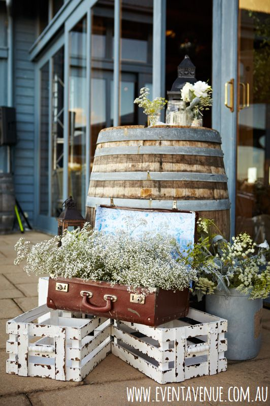 Vintage wedding ideas, vintage wedding decorations, wine barrel used as table, vintage bag used as pot for flower