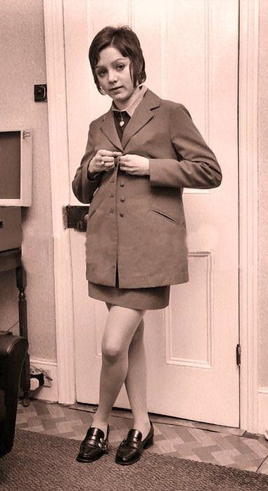 Teddy girl evolved into the 1960s, judging by the cut of her skirt and hair. No…