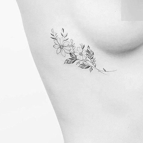 Floral tattoo ribs placement