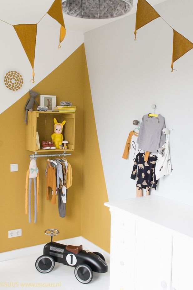 Love the mustard wall paint and all the mustard touches. A fun way to add colour to a kids room. bunting garland by #numero74