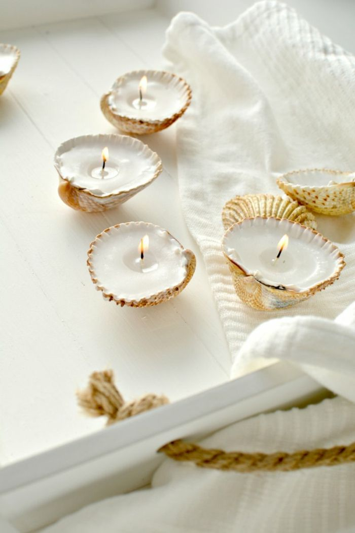 que faire avec des coquillages, bougies allumées, idée facile à réaliser