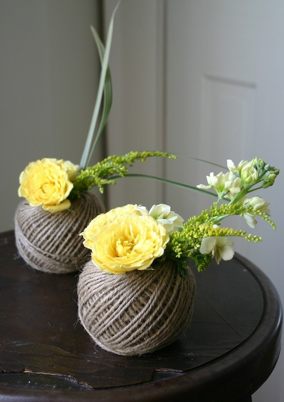 Roll of twine with a tiny container (baby food jar, maybe?) on the inside to hold water and flowers.