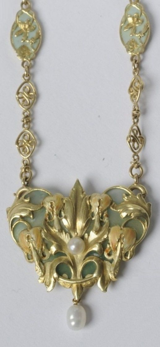 An Art Nouveau gold, enamel and pearl necklace, French, about 1900. Designed as a bleeding heart flower decorated with champlevé and plique-à-jour enamel, set with one pearl and suspending a futher pearl. Can be hung in various ways on the enamel and gold chain. With French import mark. Pendant: 4 cm. Chain: L 54 cm. #ArtNouveau #necklace | JV