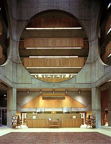 Phillips Exeter Academy Library, Exeter, NH, 1965-72 by Architect Louis Kahn. The central hall is defined by giant circular openings in the interior screen walls providing light and airiness.