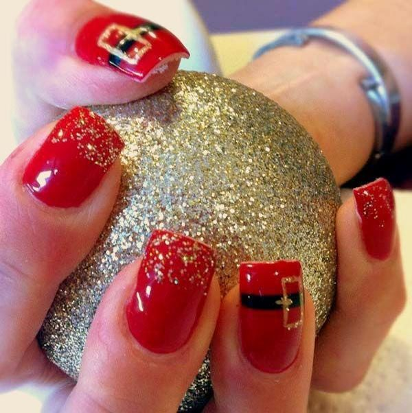 Glitter and belt themed Christmas nail art. Paint on bright red nail polish and add gold glitter as the French tip. For a cuter effect add belt details close to the tip of the nails in black and gold polish.