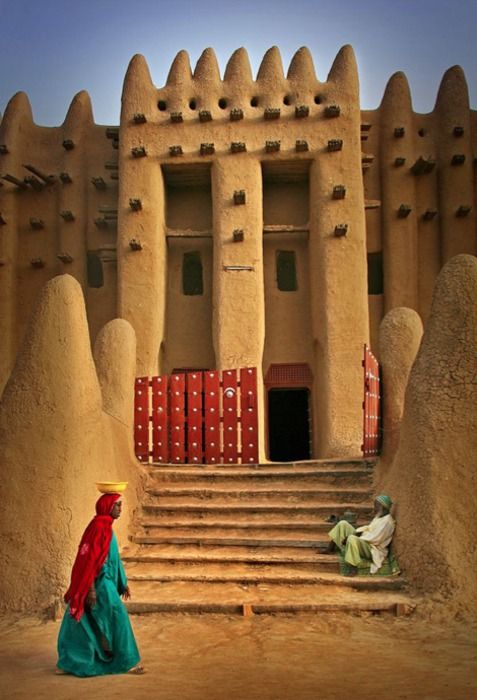 An incredible architectural feat of beauty. The Great mosque of Djenne Mali.  Is it now at risk?