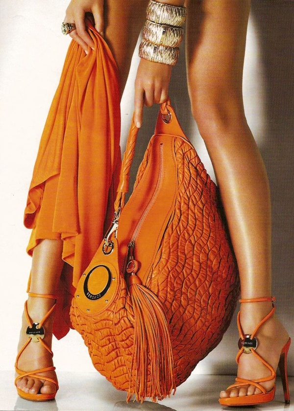 Versace ORANGE is such a cool color and so many women shy away from it, I love the whole orange combo with silver stacks, so ladies I say pick one orange accessory (bags, scarves probably best if your not comfortable with using color)  Best, original, silk scarves, silky soft, hand dyed, each stroke is strategically placed, one of a kind, original works of art, every fashionista owns one - get yours today! etsy.com/shop/SowingAcorns