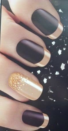 black manicure with gold chrome tips and golden accent nail