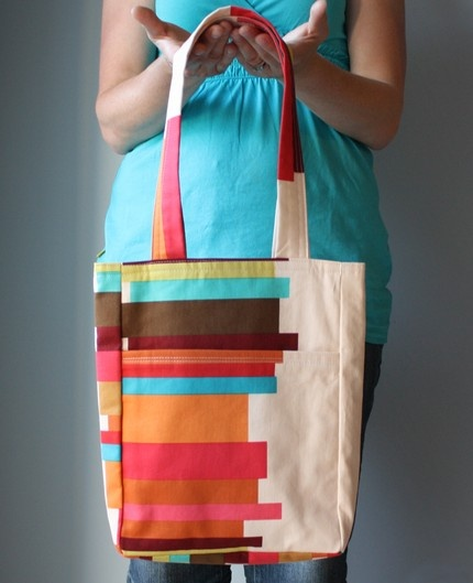 by smidgebox.etsy.com  I think I could get a plain canvas bag and put scrap fabric right on it!