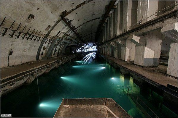In a bay on the northern shores of the Black Sea, the Soviet army maintained an elaborate submarine base throughout much of the Cold War.  Now a museum, this abandoned submarine base in the town of Balaklava, Ukraine is often explored by locals and tourists alike.