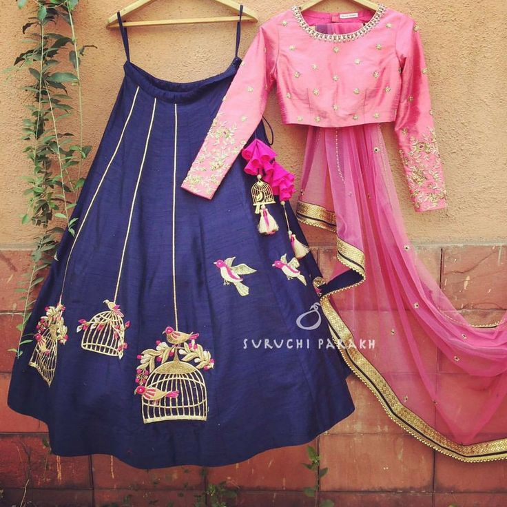 Pretty and chic dark blue and pink lehenga.