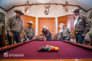 Great shot of these cowboy groomsmen