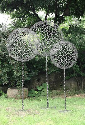 Lovely Wire Garden Art Sculptures Tree Imagine Painting The Circular Part Of That  Pattern Onto A Rock Wall. Or Making A Stencil, And Pressing It Into A  Concrete ...