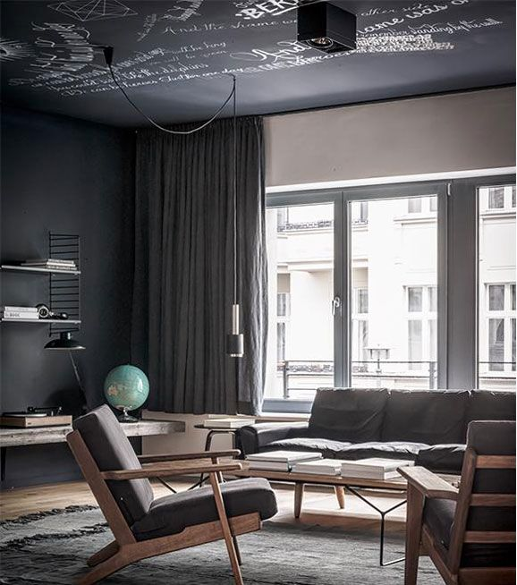 290 armchair by Hans J. Wegner from Getama, A110 pendant by Alvar Aalto from Artek and String shelves by Nils Strinning from String Furniture | Masculine Apartment in Berlin | NordicDesign