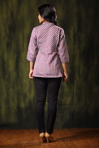 This cleverly cut top in peppermint stripes has a regal neck and an overlap. Bohemian chic. The Linen Collection