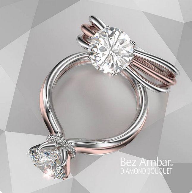A round center set in a rose and white gold three roe split shank. #diamondjewelry #engagementrings www.bezambar.com