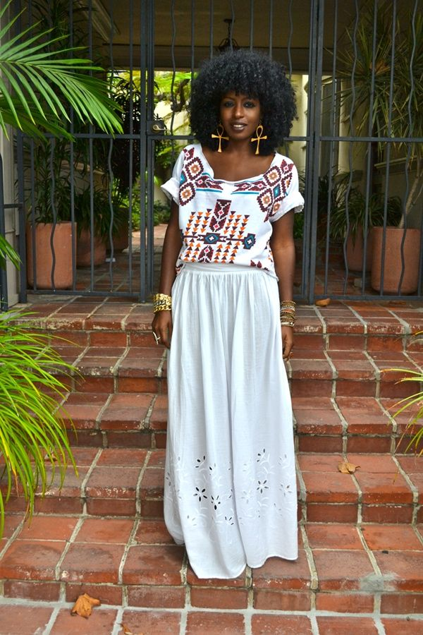 Great summer time outfit (aztec shirt with a maxi shirt; however the jewelry is what really makes this outfit come together)