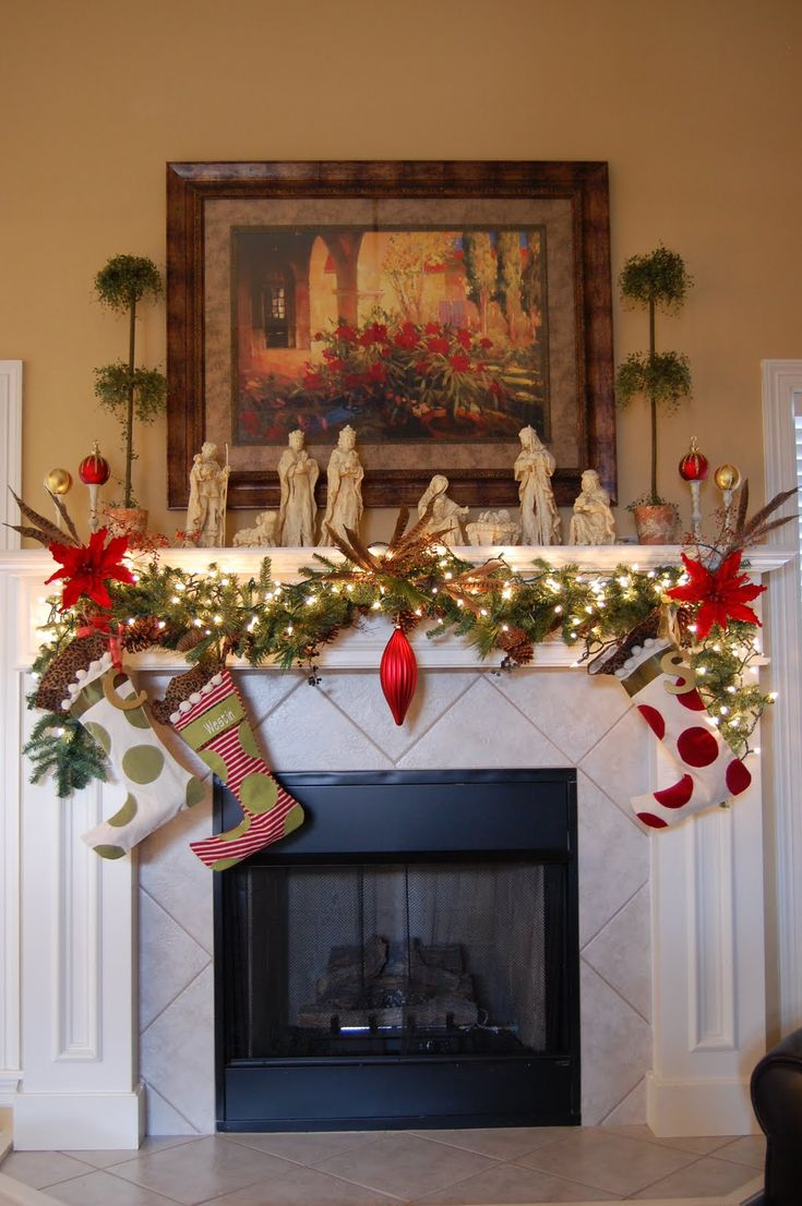 Beautiful Christmas fireplace mantel decoration with hanging trailing