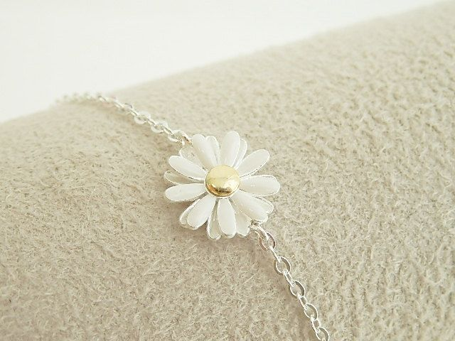 Daisy bracelet in silver, flower bracelet, everyday jewelry, bridal jewelry, bridesmaid jewelry. $14.50, via Etsy.