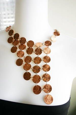 Don't really like the necklace but a good idea for maybe a single penny ( probably use a wheat penny)