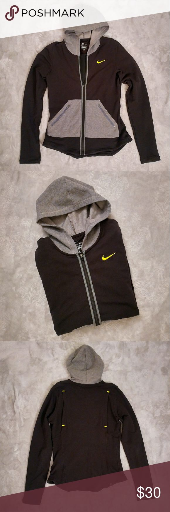 """Nike Dri-Fit Zip Up Hoodie Nike Dri-Fit Zip Up Hoodie. Like-new condition.  Bright yellow/lime green logo. Back side has """"vent"""" features with a mesh fabric on the inside to allow your body to cool if you are working out. Zippered pockets. """"Fitted"""" style hugs the body. Very comfortable! Nike Tops Sweatshirts & Hoodies"""