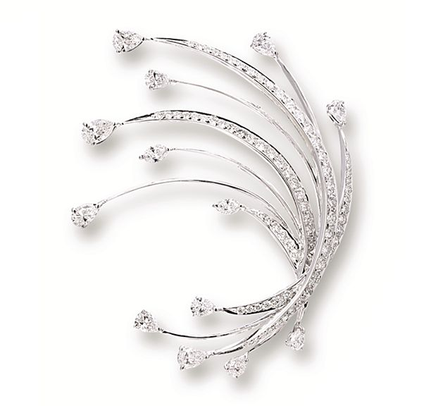 DIAMOND BROOCH, VAN CLEEF & ARPELS of foliage design, set with circular-cut and pear-shaped diamonds together weighing approximately 2.60 carats, mounted in 18 karat white gold.