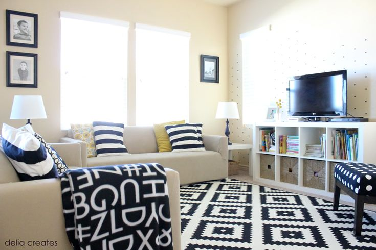 Living room idea expedit tv stand from ikea w baskets each love it also loving for Living room wall treatment ideas