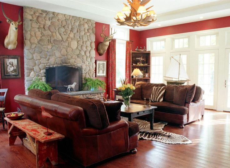 Living Room Contemporay Design Ideas With Red Wall Color Decor Along Leather Couch Cushion Also Wooden Coffee Table Vase