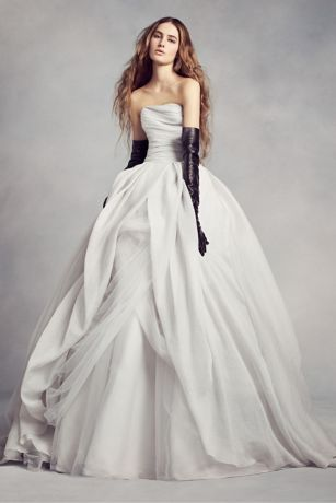 "This magnificent textured organza wedding dress with draped bodice, split-front overlay, and asymmetrical skirt is awe-inspiring.  4"" extra length gown.  This textured organza ball gown has a beautifully draped bodice, split-front overlay, and asymmetrical draped tulle skirt.  Chapel train 72"" from waist. Fully lined. Center back zip .Imported. Dry clean.  Ivory image shown with floral sash VW370111. Sterling image shown with floral sash VW370168.  Missy: Style VW351178."