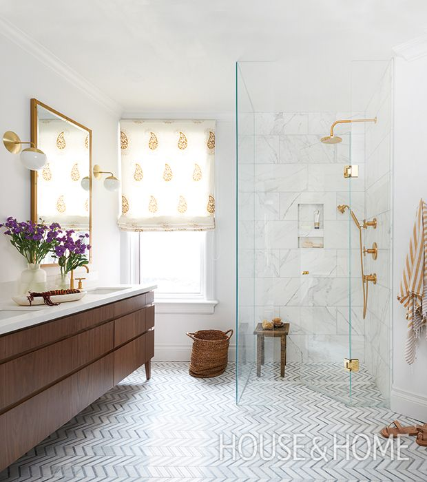 In this principal bathroom, mid-toned woods keep golden accents and expanses of marble from feeling too over-the-top.   Photographer: Alex Lukey   Designer: Sam Sacks