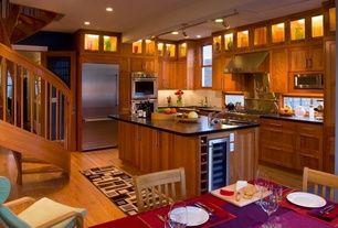 Craftsman Kitchen with Pro-track tilden four-light brushed steel led ceiling light, Quartz counters, Hardwood floors