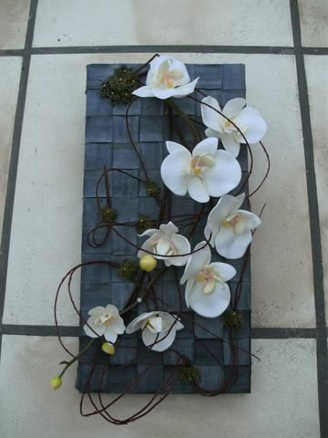 Orchids on a background made of inner tire tubes((creative-with-bicycle-tires))