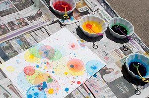 Popped Bubble Art from broogly.com. Bubble solution + food coloring. Sounds messy and fun for the kids.