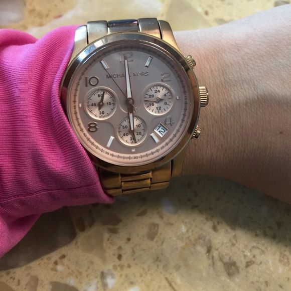 Mk rose watch Wear a few times . Got a few scratches  on the links . Got extra links. . Michael Kors Accessories Watches