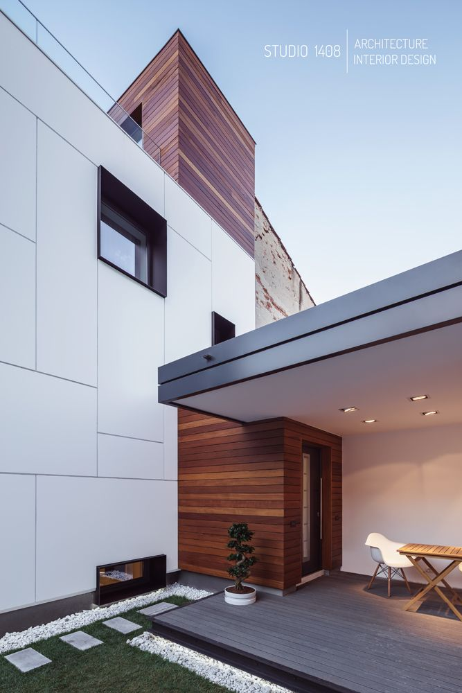 A Moelven prefabricated house turned modern cluster court