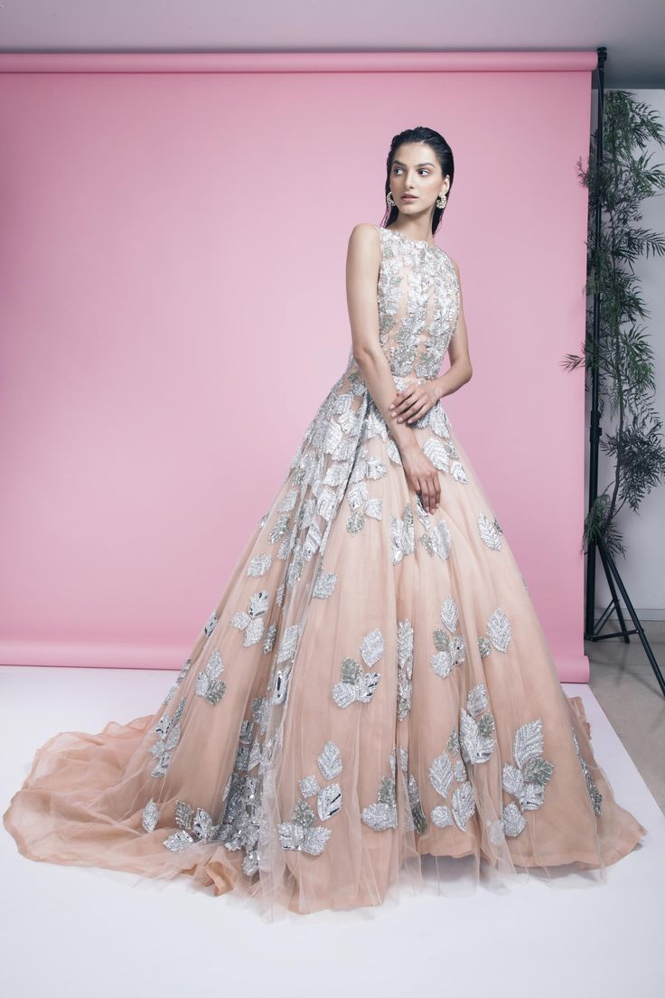 Working with the Big Guns Some our most inspiring (and exhilarating) moments were working with fashion superstars like Manish Malhotra, Anju Modi, Anita Dongre and more   Peach and silver floral appliqué work flared gown by Manish Malhotra Gold plated studded loop Earrings by Isharya