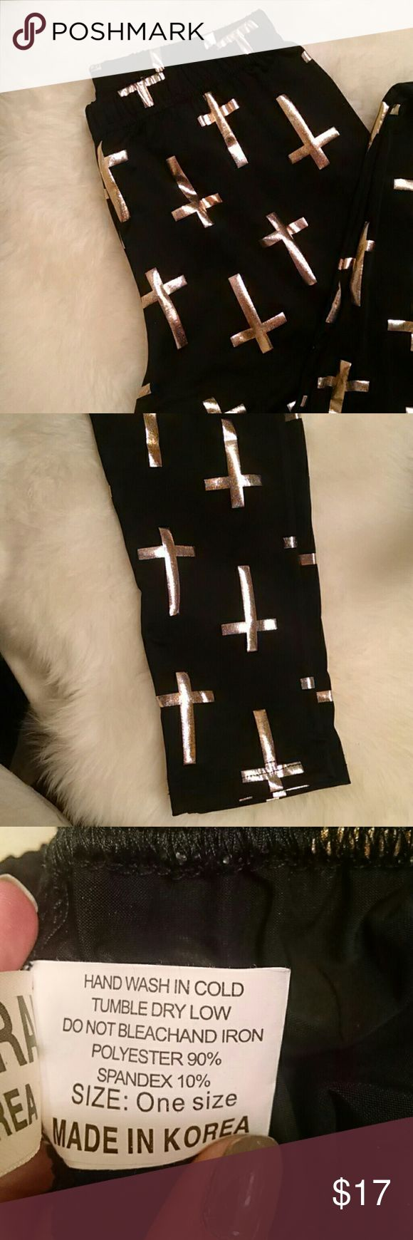 ✝Gold cross leggings✝ Black leggings with gold cross print. Worn once. Tag says one size but I would say they fit S/M.  90% polyester 10% spandex   No trades ✔ Make a FAIR offer Pants Leggings