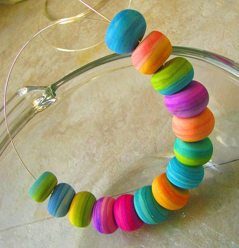"gingerblue.com - I've been working on new beads, trying to combine my love of watercolor painting with working with polymer clay. I really *don't* like the colors polymer clay comes in, so I've just started making white beads and painting them my own colors. More time consuming, but definitely more ""me""."