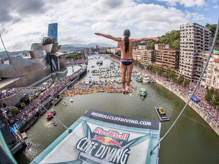 The Red Bull Cliff Diving World Series. This photo was taken in Bilbao, Spain. The city is known for its impressive architecture, which includes the Guggenheim Museum, pictured in the background on the left side.