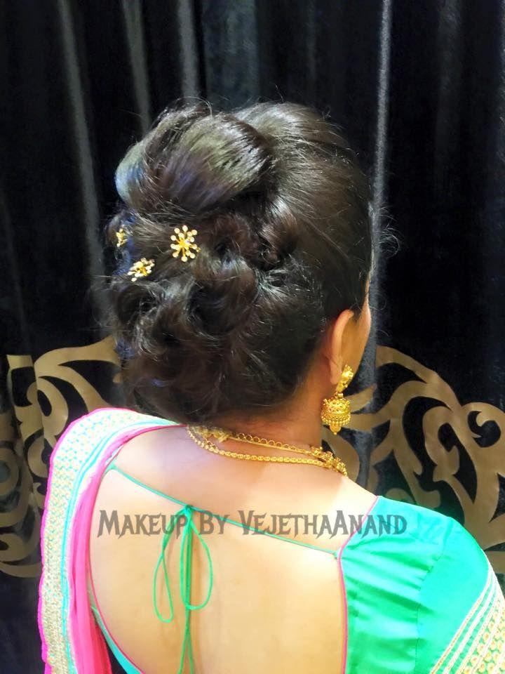 Indian bride's bridal hairstyle by Vejetha for Swank Studio. #updo #hairstyle #lehenga #HairAccessory Tamil bride. Telugu bride. Kannada bride. Hindu bride. Malayalee bride. Find us at https://www.facebook.com/SwankStudioBangalore